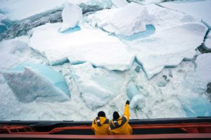 Photo of sea ice with people on ship