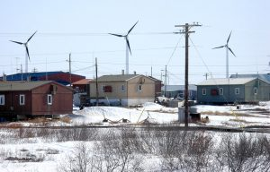 photo of wind turbines in a town